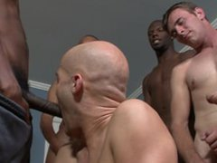 Blue eyed guy with tube shaved galore head gets gang banged and creamed