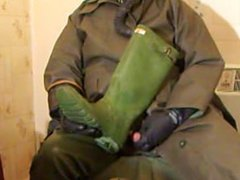 Rubber wanking in my anal new fuck waders and old oilskin mac.